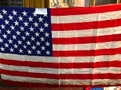 "Gently Used 53""X36"" American Flag silk like material"